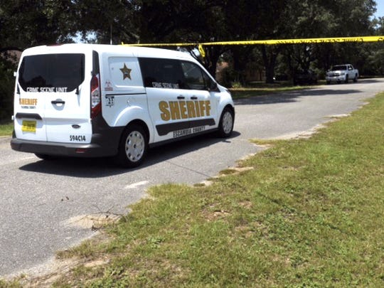 An Escambia County Sheriff's Office investigation vehicle sits on Deerfield Road.