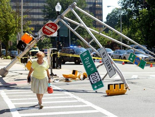Geri Magala of Morristown crosses the street as traffic