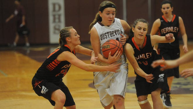 Dayton's Angela Sikora tries to drive through two defenders during a game earlier this season against Fernley.