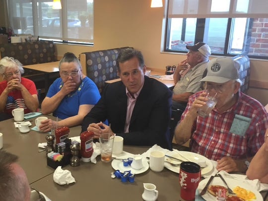 Rick Santorum answers questions Thursday for diners at the Hy-Vee Market Grille in Chariton, Iowa.