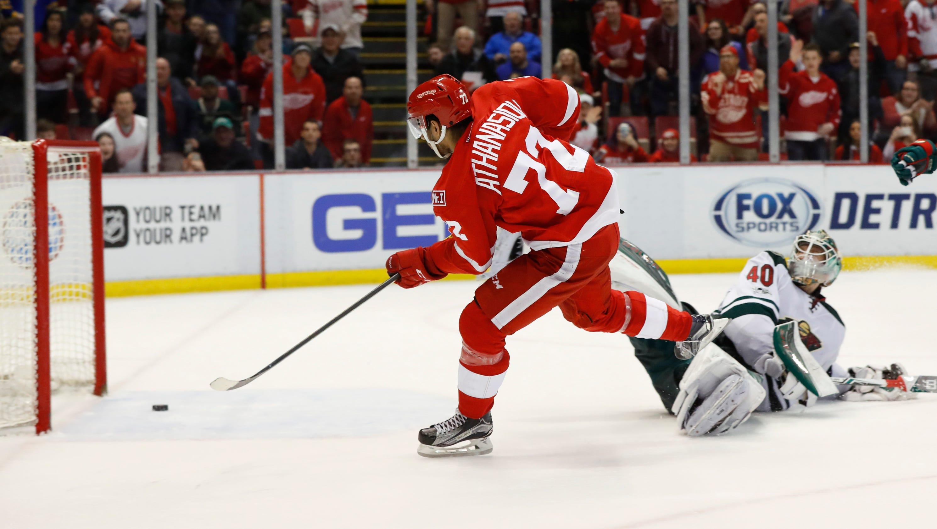 636261385588225112-ap-wild-red-wings-hockey-mip-5-