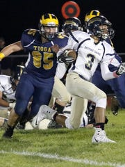 Kyreese Fisher carries the ball for Elmira Notre Dame