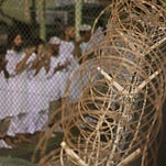 Detainees pray before dawn inside a detention facility at Guantanamo Bay, Cuba.