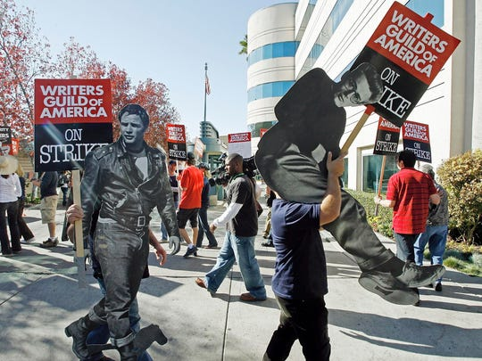 Striking writers in November 2007, carrying life-sized