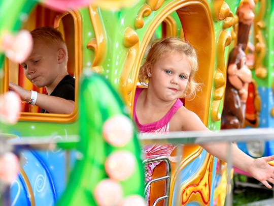 Hudson Henry, 5, left, and Aaralyn Henry, 4, both of West Manchester Township, ride the Circus Train during York Fair in York City, Thursday, Sept. 14, 2017. Dawn J. Sagert photo