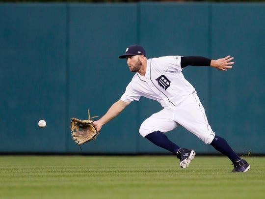 Tigers centerfielder Tyler Collins fields a single