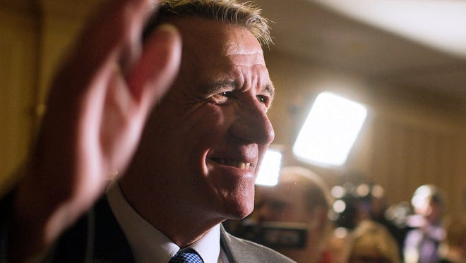 In this Nov. 8, 2016, file photo, Vermont Republican Gov.-elect Phil Scott waves to a room full of supporters at the Sheraton Burlington Hotel in South Burlington. Scott has been in talks with Gov. Charlie Baker of Massachusetts and Gov. Larry Hogan of Maryland about how to work together in dealings with the incoming Trump administration. The three Republicans were critical of Trump during the campaign.