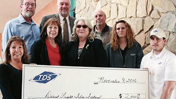From left to right, Alamogordo TDS Manager Barbara Mick, Festival Director Joan Griggs, Otero County Film Liaison Jan Wafful, Tiffany Martin, Cliff Wilson. Second row from left to right: Bruce Martin of New Mexico State Univeristy-Alamogordo NMSU-A President Ken VanWinkle and NMSU-A Alamogordo Division-Head Bryan Yancey present a check from TDS that goes to assist the film festival.