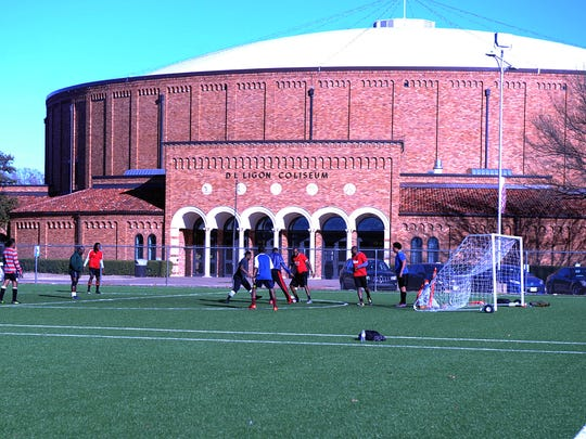 Men play soccer on the Midwestern State turf fields in January.