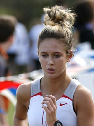 Holliday's Chloe Zeisman (1660) runs in the Class 3A State Cross Country Championships at Old Settlers Park on Saturday. The Holliday girls finished fifth.
