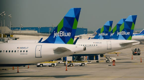 Jet Blue planes at New  York's JFK Airport on June