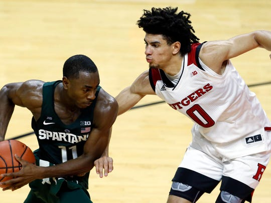 Rutgers Scarlet Knights guard Geo Baker (0) defends against Michigan State Spartans guard Lourawls Nairn Jr. (11)