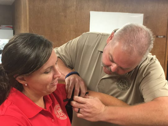 Paramedic and Tylertown police officer Jess Greer applies a tourniquet to 14th Circuit Drug Court officer Pam Weber's arm in a class in McComb on Tuesday.