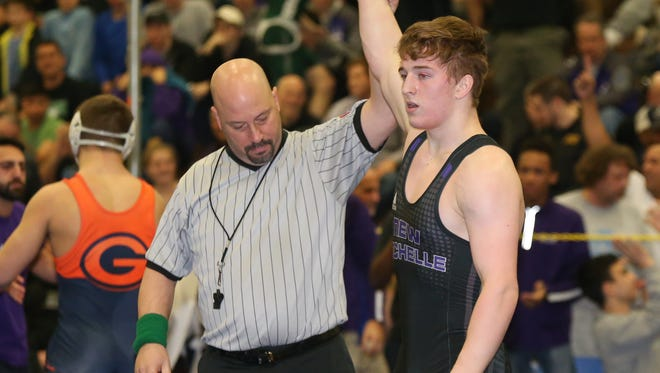 New Rochelle's Jake Logan defeats Horace Greeley's Jacob Ferreira in the 182-pound match at the Section 1, Division 1 wrestling finals at Clarkstown High School South in West Nyack on Sunday, February 11, 2018.