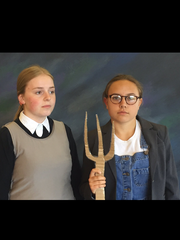 "Mackenzie Todd, left, and Lauren Tousignant, both Sioux Falls Christian students, posed as the famous ""American Gothic"" painting for their school photos."