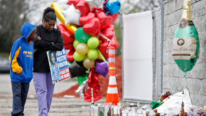 Mourners pray for O'Bryan Spikes and the 16 injured following the shooting at the Cameo nightclub, Tuesday, March 28, 2017, in Linwood.