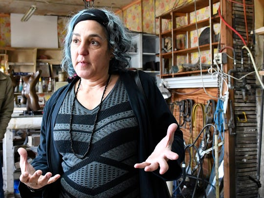 Tamina Karem talks about the process needed to make sculptures at the Bright Foundry, Thursday, Dec. 8, 2016 in Louisville Ky.