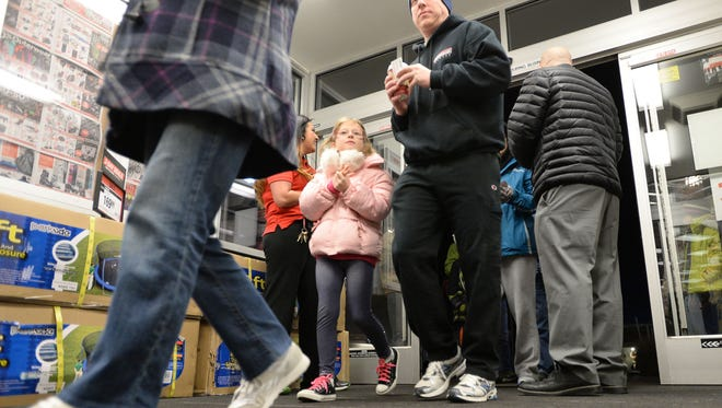 Shoppers flood into the Sports Authority store in Front Range Village on Black Friday in 2013.