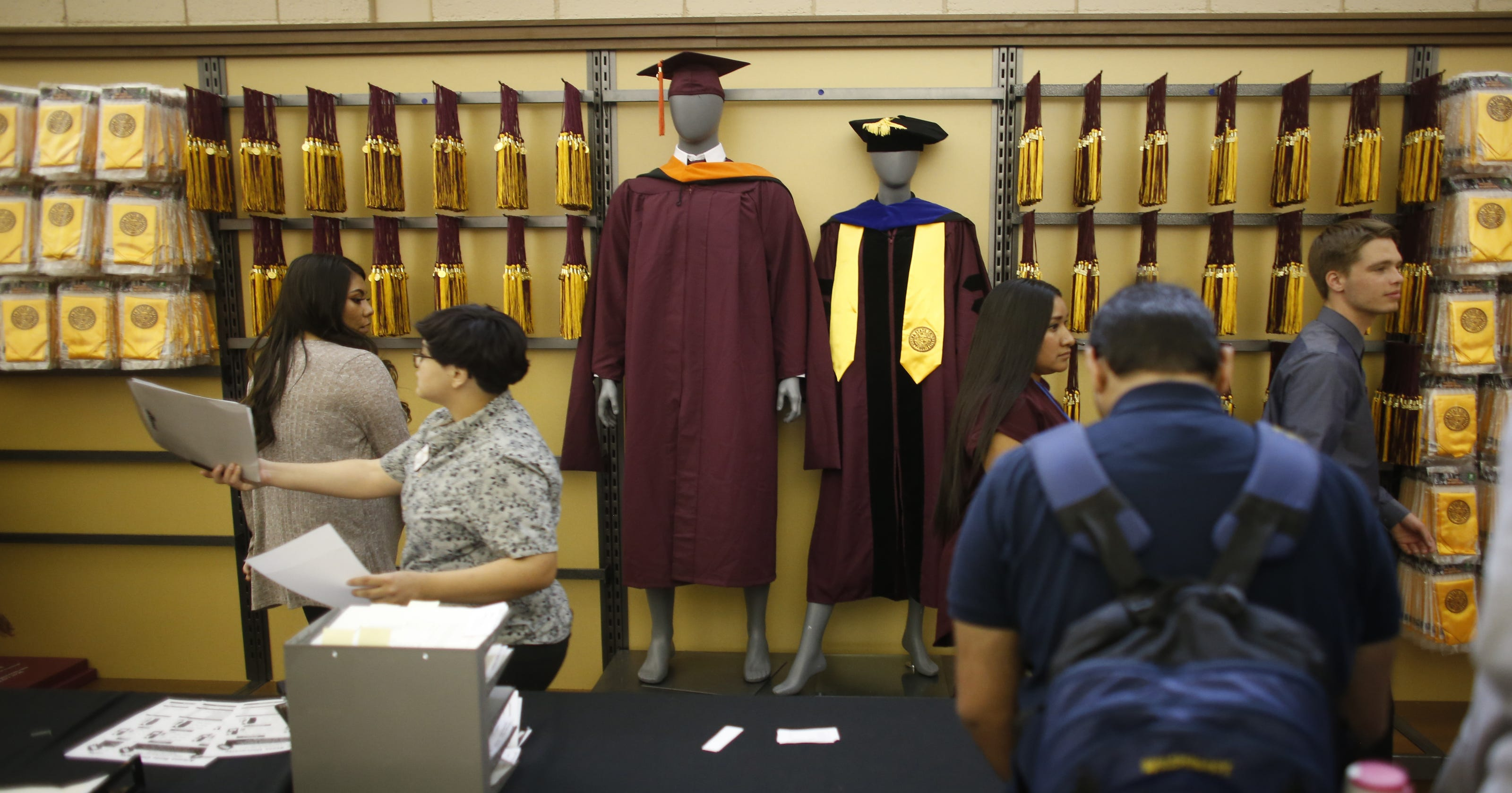 ASU students purchase caps and gowns
