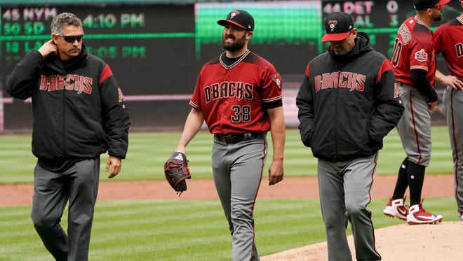 Arizona Diamondbacks starting pitcher Robbie Ray (38) leaves the game during the second inning of a baseball game against the Washington Nationals at Nationals Park Sunday, April 29, 2018, in Washington.