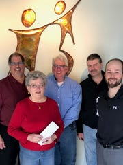 2018 Bowl For Kids' Sake top pledge raisers (from left): Chuck Webster, Rita Meunch, Richard Varga, Rob Sisel and Big Brothers Big Sisters of Manitowoc County Executive Director Joel Evenson. Missing from the photo: DeeDee Kadow, Chad Zeller and Mike Jagemann.