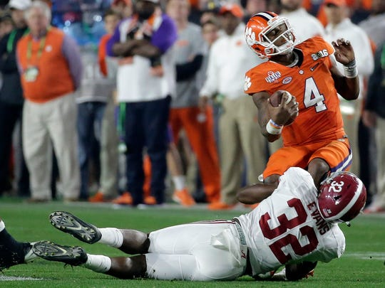 FILE - In this Jan. 11, 2016, file photo, Alabama's Rashaan Evans (32) sacks Clemson quarterback Deshaun Watson during the second half of the NCAA college football playoff championship game in Glendale, Ariz. Evans, the star of Alabama's injury-depleted group, has had a big season on the field and graduated off it. He's also shined in the past two national title games (AP Photo/Chris Carlson, File)