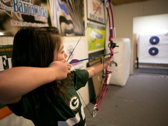 Makenzie Fehrenbach, 7, of Saratoga takes aim at the target with her bow and arrow at Timberline Archery in Saratoga, Tuesday, March 17, 2015. Makenzie Fehrenbach is Kam Fehrenbach's daughter. Fehrenbach said Makenzie loves the sport as much as she does and will soon have her own bow.