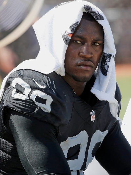 FILE - In this Sept. 20, 2015, file photo, Oakland Raiders' Aldon Smith cools off during an NFL football game against the Baltimore Ravens in Oakland , Calif. Police are searching for suspended Smith, who is suspected of domestic violence. San Francisco police said Sunday, March 4, 2018, that Smith fled a San Francisco home Saturday night after someone called the police to report a domestic violence incident. (AP Photo/Tony Avelar, File)