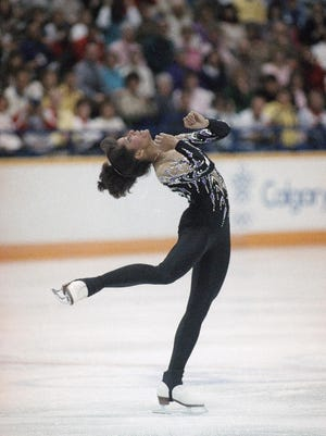 Debi Thomas of San Jose, Calif., goes through routine during practice on Sunday, Feb. 21, 1988 in Calgary. Thomas skates against Katarina Witt of East Germany in the Olympic women?s figure skating competition that starts on Wednesday.
