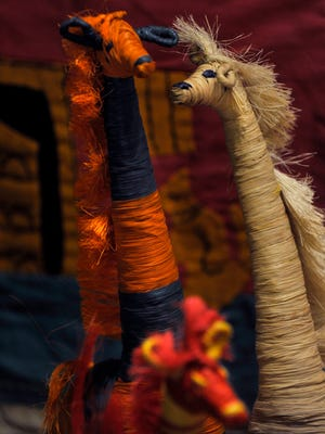 Raffia animals from Madagascar on display at Eternal Threads Oct. 5, 2017. The store which features Fair Trade artisan products, will close its physical store Oct. 31.