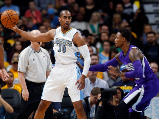 Denver Nuggets guard Arron Afflalo, left, looks to pass the ball as Sacramento Kings guard Ben McLemore covers in the first half of an NBA basketball game in Denver on Monday, Nov. 3, 2014. (AP Photo/David Zalubowski)