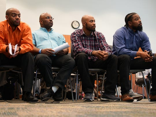 Participants in the HomeWorks, Interfaith Community Housing's pre-apprenticeship workforce training program listen to members of the Senate Labor Committee speak at a public hearing, discussing the circumstances that led to alleged abuses of participants in the program.