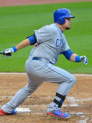 Cubs designated hitter Kyle Schwarber hits an RBI single in the third inning against the Cleveland Indians at Progressive Field on Wednesday.