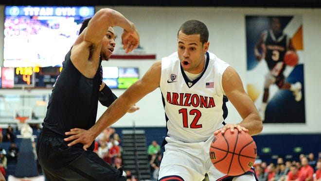 Nov 26, 2015: Arizona Wildcats forward Ryan Anderson (12) is defended by Santa Clara Broncos guard Jarvis Pugh (4) during the first half at Titan Gym.
