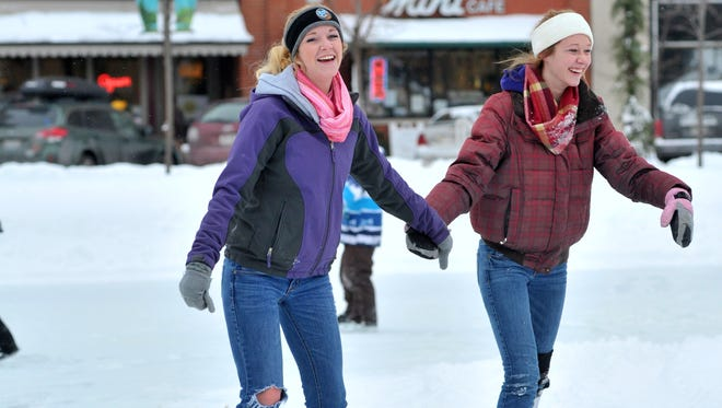 In this 2013 file photo, Kennedy Bianco, left, and her sister Amber, both of Hatley, skate at the ice rink on The 400 Block in downtown Wausau.
