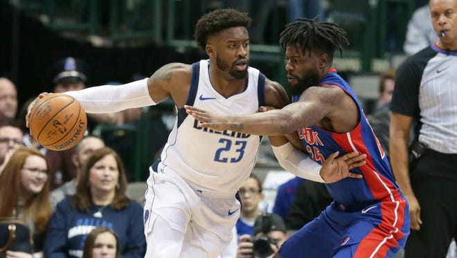 Mavericks guard Wesley Matthews dribbles against Pistons forward Reggie Bullock during the first half in Dallas, Wednesday.