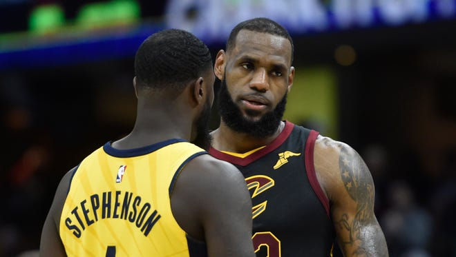 Cleveland Cavaliers forward LeBron James (23) stands beside Indiana Pacers guard Lance Stephenson (1) in the fourth quarter in game one of the first round of the 2018 NBA Playoffs at Quicken Loans Arena.