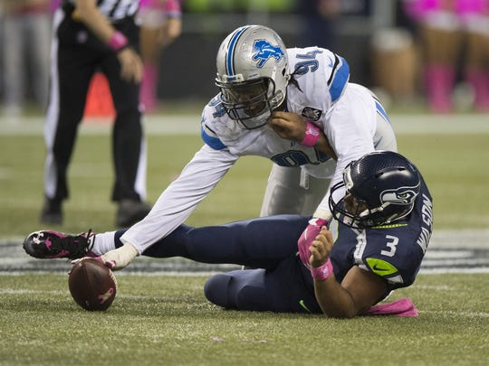Lions defensive end Ziggy Ansah goes after a fumble by Seahawks quarterback Russell Wilson.