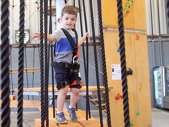Joey Sciuto, 8, enjoys one of the courses at Spins