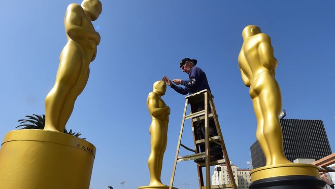 FREDERIC J. BROWN,  AFP, Getty Images Scenic artist Sam Costa works on touching up statues of Oscar due to go onto the red carpet from a backlot off Hollywood Boulevard in Hollywood, California on February 19, 2015 amid preparations for the 87th Academy Awards on February 22.  AFP PHOTO / FREDERIC J. BROWNFREDERIC J. BROWN/AFP/Getty Images ORIG FILE ID: 538034787