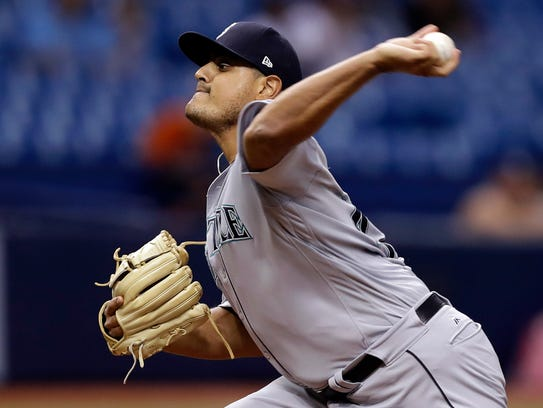 Seattle Mariners relief pitcher James Pazos delivers