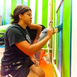 Before official dedication, Boys & Girls Club members add color to teen center