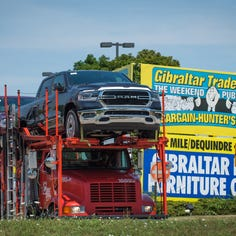 Why are so many Ram trucks parked at Gibraltar Trade Center?