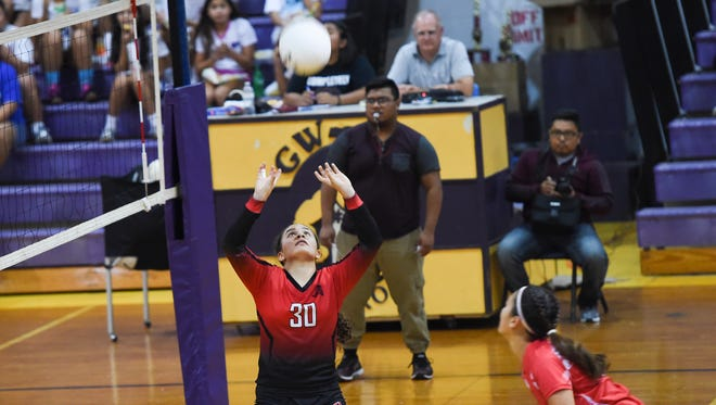 In this file photo from 2017, the George Washington High School Geckos took on the St. John's School Knights during the Shieh Volleyball Invitational at the GW High School Gym on Aug. 18.