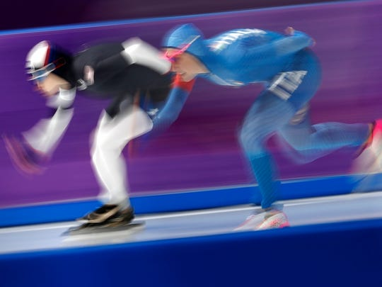 Mia Manganello of the United States, left, and Francesca Lollobrigida of Italy, right, compete during the women's 1,500 meters speedskating race at the Gangneung Oval at the 2018 Winter Olympics in Gangneung, South Korea, Monday, Feb. 12, 2018. (AP Photo/Petr David Josek)
