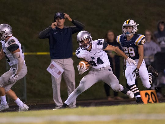 ReitzÕs Andrew Word (24) runs down the sideline against Castle at John Lidy Field Friday night.