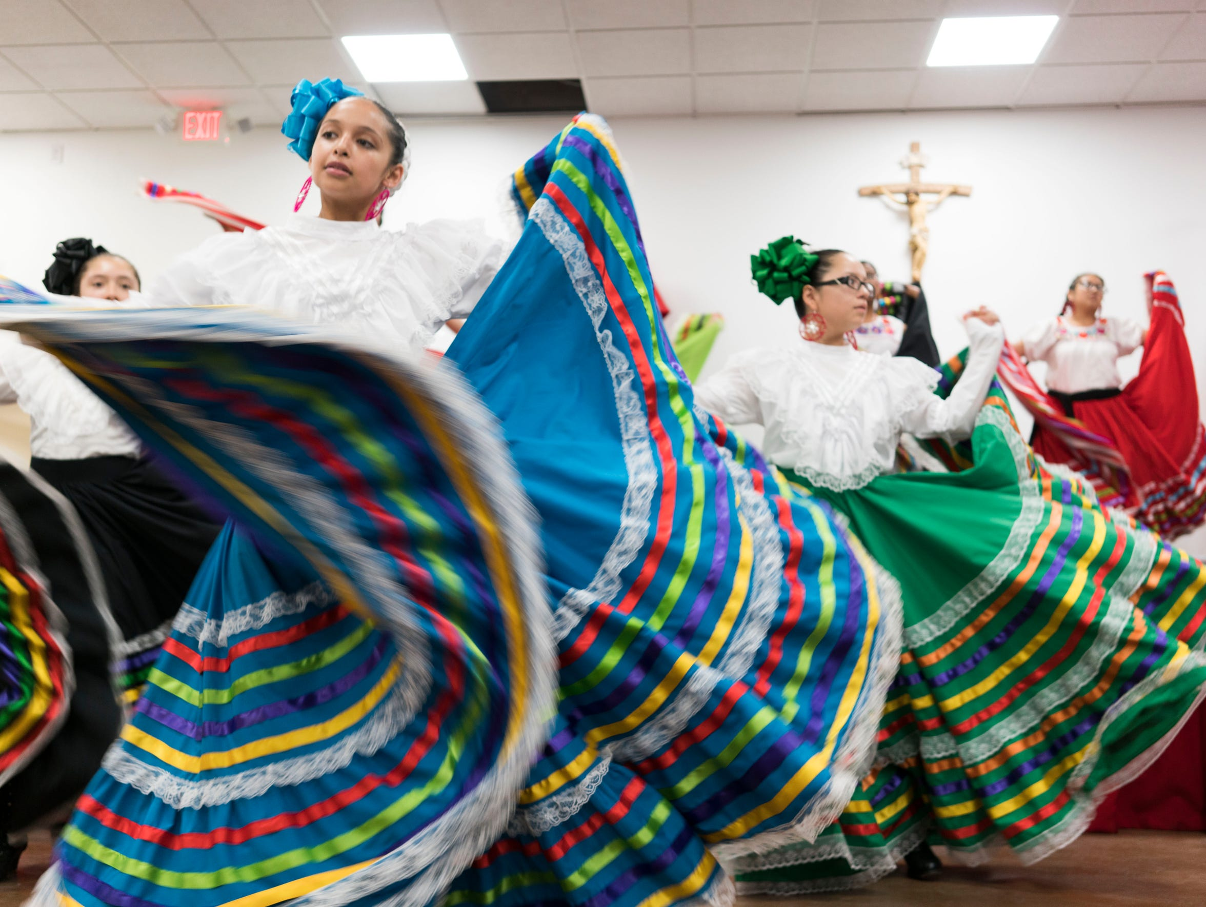 Latino families watch the traditional Mexican Mariachi