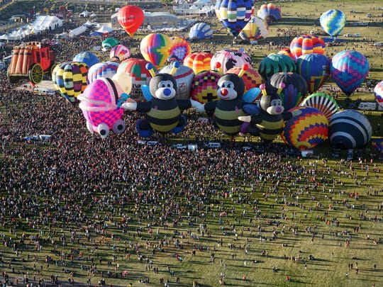 A massive crowd gathers to watch the morning mass ascension of balloons during the 2017 Albuquerque International Balloon Fiesta on Saturday, Oct. 14, 2017.