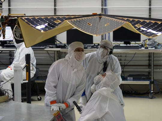 A worker in a clean room at the Lockheed Martin satellite