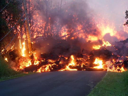 Lava pours down a road in the Leilani Estates neighborhood